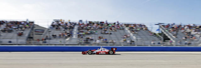 Tony Kanaan makes his way through turn four during the Milwaukee Mile IndyCar auto race Sunday, Aug. 17, 2014, in West Allis, Wis. (AP Photo/Morry Gash)