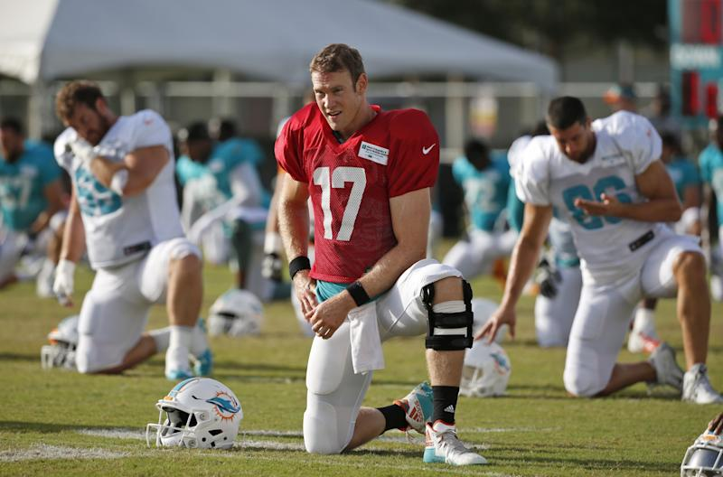 Not what they knee-d: Dolphins QB Ryan Tannehill left Thursday's practice with an apparent knee injury. (AP)
