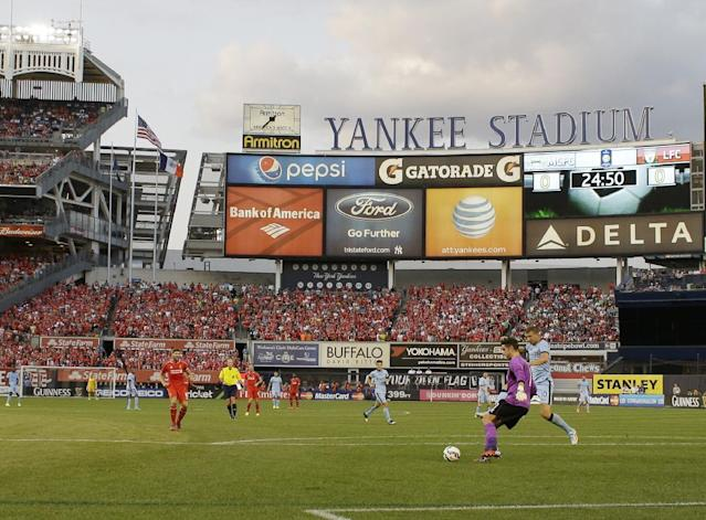 Liverpool goalkeeper Brad Jones and Manchester City's Edin Dzeko, right, fight for control of the ball in the first half of a Guinness International Champions Cup soccer tournament match Wednesday, July 30, 2014, in New York. (AP Photo/Frank Franklin II)
