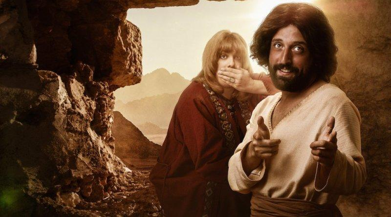 Jesus ~(front right) with a 'friend' beleived to be lover (behind) stand in a cave while Jesus points finger guns at the camera and the friend covers his mouth in promotional image for Netflix show