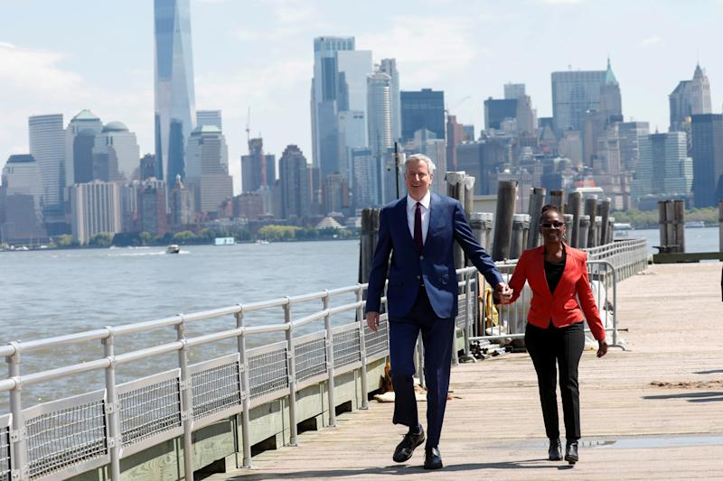 New York City Mayor and Democratic Presidential candidate Bill de Blasio arrives at Liberty Island with his wife Chirlane McCray to attend the dedication of the new Statue of Liberty Museum in New York Harbor, U.S., May 16, 2019. REUTERS/Mike Segar TPX IMAGES OF THE DAY