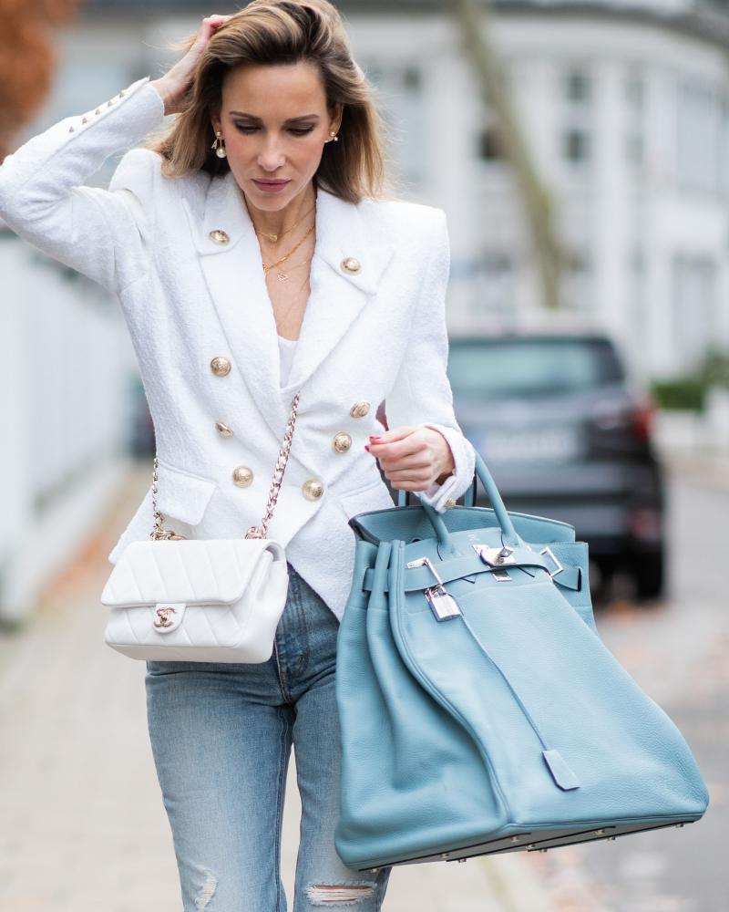 Big bags are back. Pictured, the fashion blogger Alexandra Lapp with an oversized Hermès Birkin bag on 10 December.