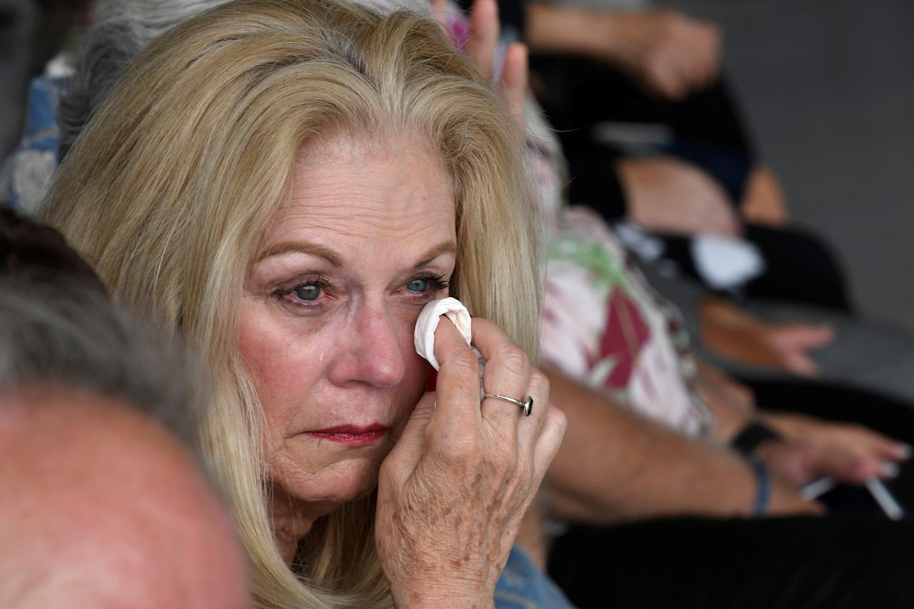 <p>A woman cries as caskets containing the remains of American servicemen from the Korean War handed over by North Korea arrive at Joint Base Pearl Harbor-Hickam in Honolulu, Hawaii, Aug. 1, 2018. (Photo: Hugh Gentry/Reuters) </p>