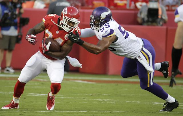 Kansas City Chiefs running back Knile Davis (34) is tackled by Minnesota Vikings linebacker Anthony Barr (55) during the first half of an NFL preseason football game in Kansas City, Mo., Saturday, Aug. 23, 2014. (AP Photo/Charlie Riedel)