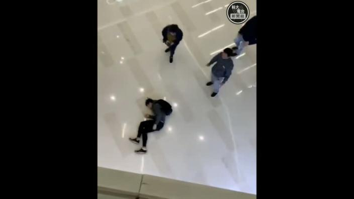 A man lies on the floor after he jumped from the second storey in Yuen Long mall as he tried to evade police in Hong Kong