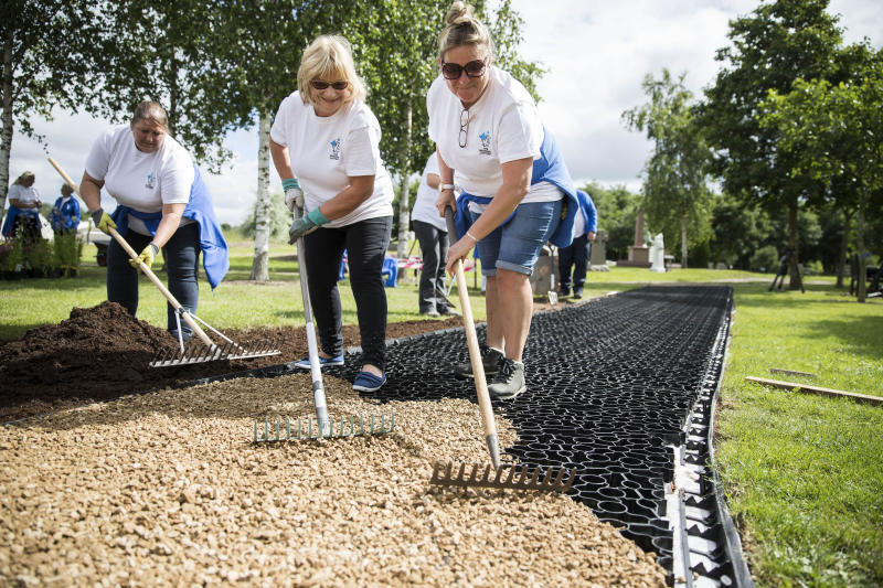 Volunteers build a new walkway and garden at The National Memorial Arboretum in Staffordshire. Photo: Fabio De Paola/PA Archive/PA Images