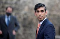 FILE PHOTO: Britain's Chancellor of the Exchequer Rishi Sunak looks on as he leaves following an outside broadcast interview, in London