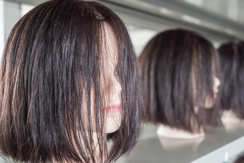 A mannequin with a wig