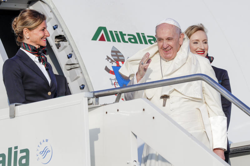 Pope Francis waves as he boards an aircraft on his way to Maputo, Mozambique, in Rome's Fiumicino International airport, Wednesday, Sept. 4, 2019. Pope Francis heads this week to the southern African nations of Mozambique, Madagascar and Mauritius, visiting some of the world's poorest countries in a region hard hit by some of his biggest concerns: conflict, corruption and climate change. (AP Photo/Andrew Medichini)