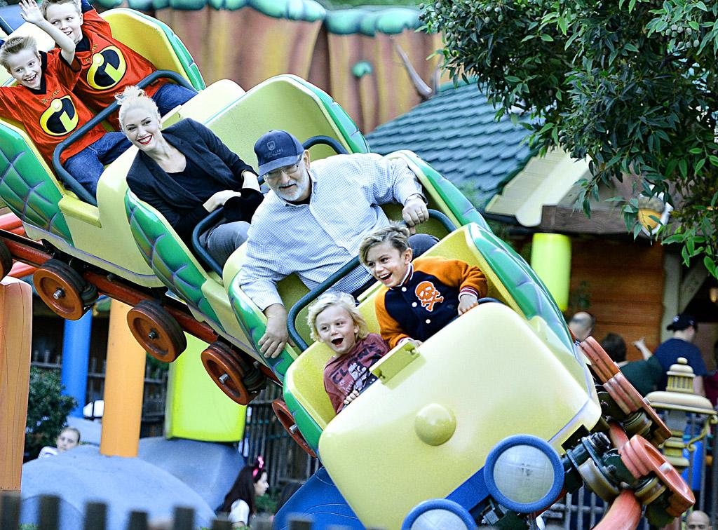 EXCLUSIVE: Gwen Stefani was all smiles while taking a ride on Disneyland's Gadget's Go Coaster with her father Dennis and her two boys Kingston and Zuma. The family rode the roller coaster twice which is located in Toontown. Afterwards, the singer and her kids watched the Christmas parade.  Pictured: Gwen Stefani, Dennis Stefani, Zuma Rossdale, Kingston Rossdale Ref: SPL470591  121212   EXCLUSIVE Picture by: Sharpshooter Images / Splash   Splash News and Pictures Los Angeles:310-821-2666 New York:212-619-2666 London:870-934-2666 photodesk@splashnews.com