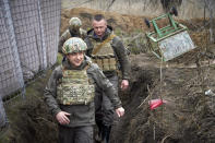 FILE - In this April 9, 2021 file photo, Ukrainian President Volodymyr Zelenskyy visits the war-hit Donbas region, eastern Ukraine. Ukrainians hold strong hopes for the visit of the U.S. Secretary of State — increased military aid and strong support for NATO membership among them. By coming to Ukraine so early in his tenure, before any trip to Russia, Antony Blinken is signaling that Ukraine is a high foreign-policy priority for the President Joe Biden administration. (Ukrainian Presidential Press Office via AP, File)