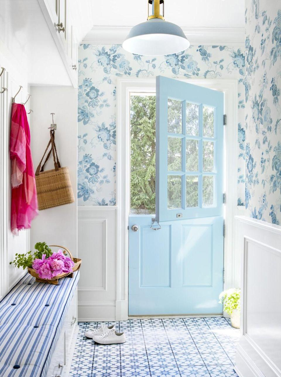 """<p>Match your mudroom with the cheeriness of this bright blue door to leave you in a wonderful mood every time you leave your house.</p><p><a class=""""link rapid-noclick-resp"""" href=""""https://store.benjaminmoore.com/storefront/color-samples/paint-color-samples-1-pint/prodPRM01A.html?sbcColor=793"""" rel=""""nofollow noopener"""" target=""""_blank"""" data-ylk=""""slk:SHOP WATERCOLOR BLUE BY BENJAMIN MOORE"""">SHOP WATERCOLOR BLUE BY BENJAMIN MOORE</a></p>"""