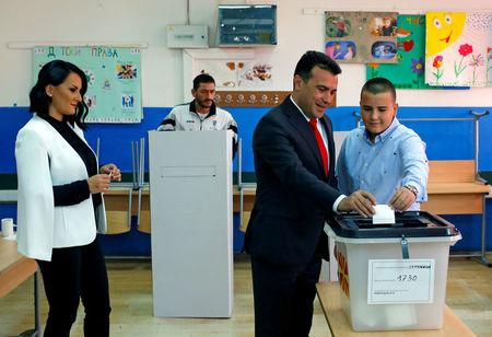 Macedonia's PM Zoran Zaev, his wife Zorica and his son Dushko cast their ballot for the referendum in Macedonia on changing the country's name that would open the way for it to join NATO and the European Union in Strumica