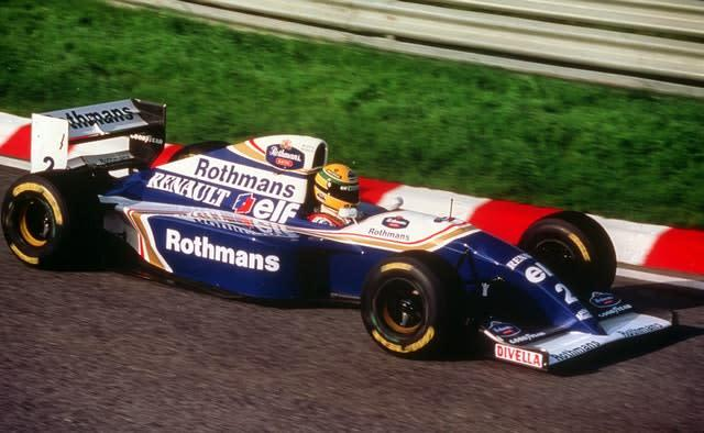 Senna test-drives the new Rothmans Williams Renault at Estoril, Portugal, in 1994 (PA)
