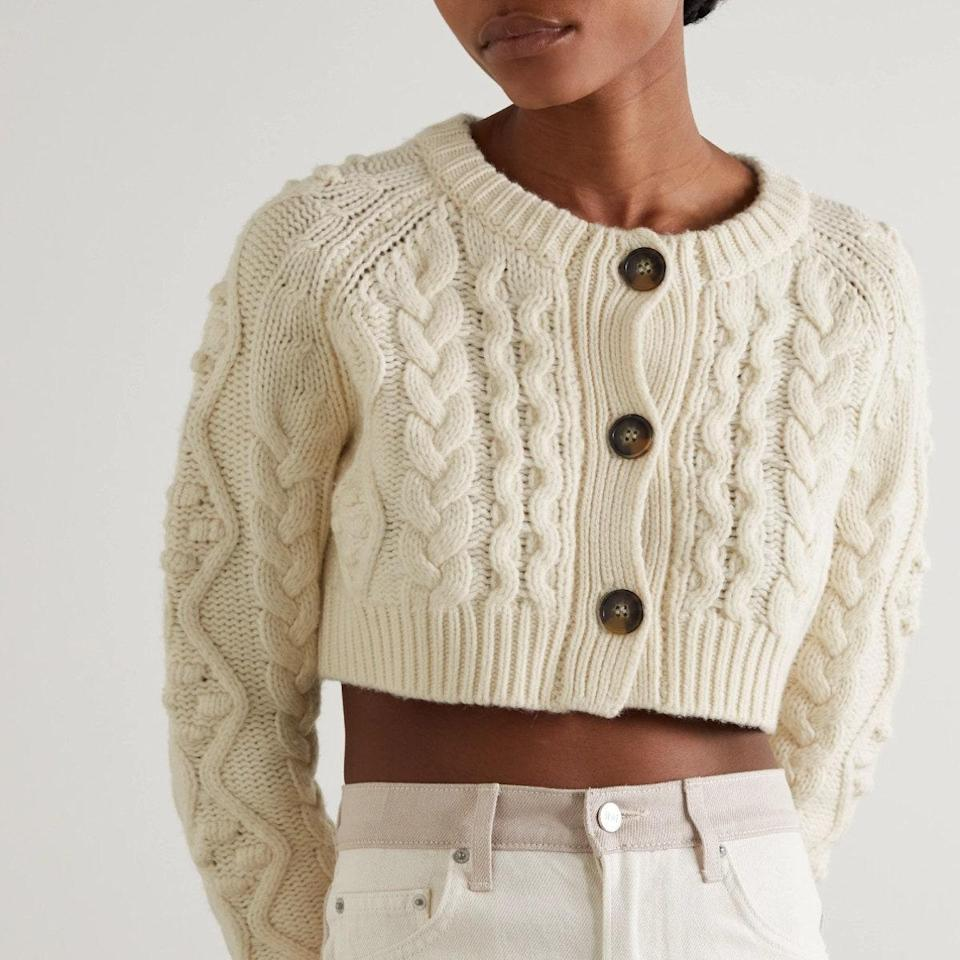 """Lean into sweater weather with this cropped cutie that would look so on-point with creamy trousers and white <a href=""""https://www.glamour.com/gallery/best-fall-loafers?mbid=synd_yahoo_rss"""" rel=""""nofollow noopener"""" target=""""_blank"""" data-ylk=""""slk:platform loafers"""" class=""""link rapid-noclick-resp"""">platform loafers</a>. $365, Net-a-Porter. <a href=""""https://www.net-a-porter.com/en-us/shop/product/loulou-studio/clothing/cardigans/abaco-cropped-cable-knit-wool-and-cashmere-blend-cardigan/15546005221874298"""" rel=""""nofollow noopener"""" target=""""_blank"""" data-ylk=""""slk:Get it now!"""" class=""""link rapid-noclick-resp"""">Get it now!</a>"""
