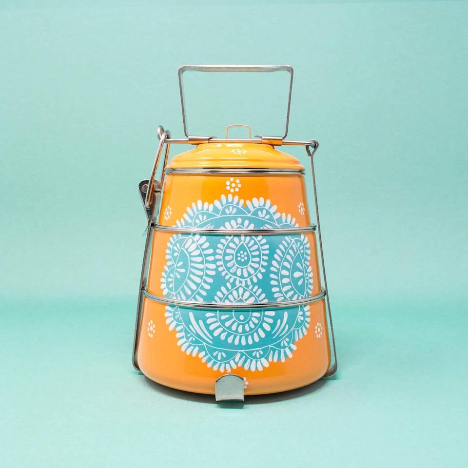 """Or pack up your meal with this equally chic option from the brand that has a neat handle and stackable compartments to keep everything separate until chow time. $47, GlobeIn. <a href=""""https://shop.globein.com/products/tiffin-orange-with-teal"""" rel=""""nofollow noopener"""" target=""""_blank"""" data-ylk=""""slk:Get it now!"""" class=""""link rapid-noclick-resp"""">Get it now!</a>"""