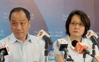 Workers' Party chief Low Thia Khiang and chairman Sylvia Lim counter the People's Action Party leaders' criticism of their proposals. (Yahoo! photo/Fann Sim)