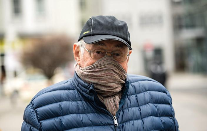 """<span class=""""caption"""">People have resorted to using scarves and bandanas as face masks to protect against spreading coronavirus. While cloth masks aren't as effective as surgical masks, research suggests they can limit the spread of droplets.</span> <span class=""""attribution""""><a class=""""link rapid-noclick-resp"""" href=""""http://gettyimages.com"""" rel=""""nofollow noopener"""" target=""""_blank"""" data-ylk=""""slk:Jens Schleuter/Getty Images"""">Jens Schleuter/Getty Images</a></span>"""