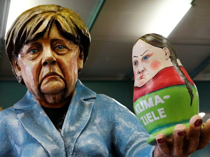 Figures for carnival floats depicting Merkel and Thunberg.