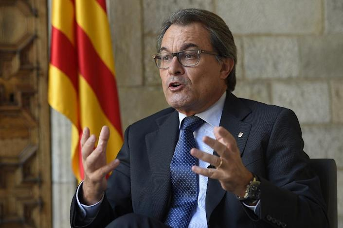Catalonia's regional government president Artur Mas says the region will not need a referendum to break away from Spain if pro-separatist candidates win a majority of votes in Sunday's regional election (AFP Photo/Lluis Gene)
