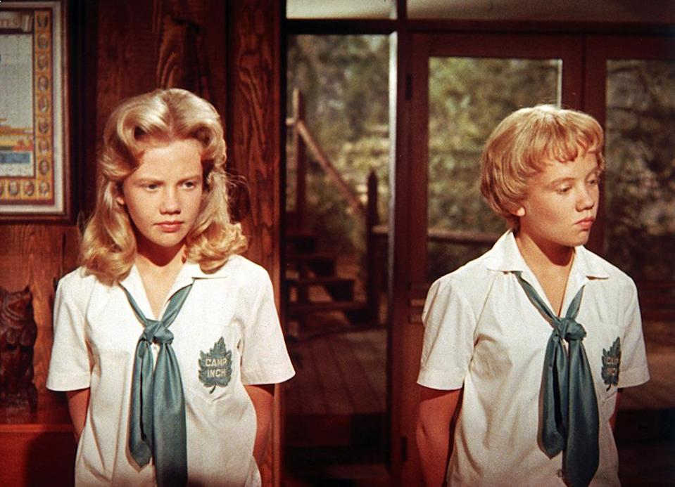 <p>Arguably the most famous movie where in one actress plays the role of two twins, Mills portrays a set of identical sisters separated at birth who later scheme — and sing! — in order to reunite their divorced parents. <i>(Photo: Everett Collection)</i></p>
