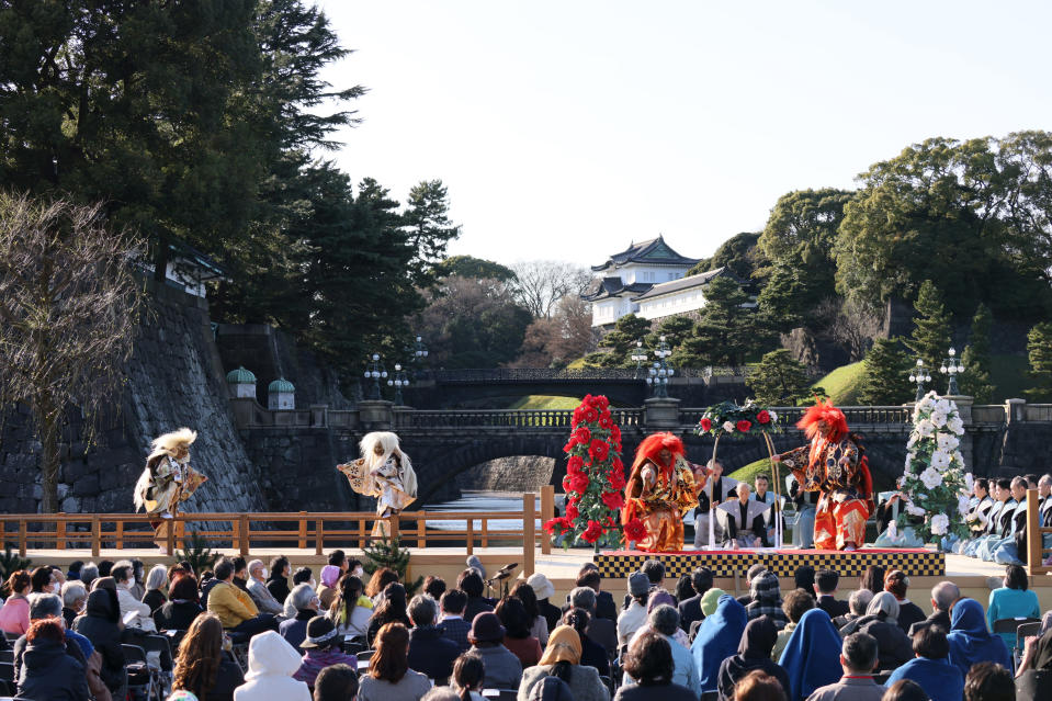 In this photo released by Japan Arts Council, spectators watch Kiyokazu Kanze and other members of the Kanze School of the Japanese traditional theater of Noh perform on stage at the Kyoko Gaien National Garden near Imperial Palace, background, in Tokyo on March 14, 2021. The Japan Cultural Expo, a government-backed program set up especially to drum up tourism during the Tokyo Olympics, was planning similar events for the Games to highlight Japanese culture, but Tokyo Olympic organizers and the IOC on Saturday, March 20, 2021 announced a ban on fans from abroad attending the the games, which open on July 23. (Ken Kikaido/© Japan Arts Council via AP)