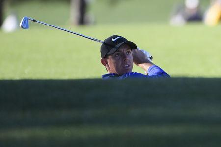 Apr 4, 2017; Augusta, GA, USA; Rory McIlroy watches the flight of his shot from a bunker on the first hole during Tuesday practice rounds at at Augusta National GC. Mandatory Credit: Michael Madrid-USA TODAY Sports