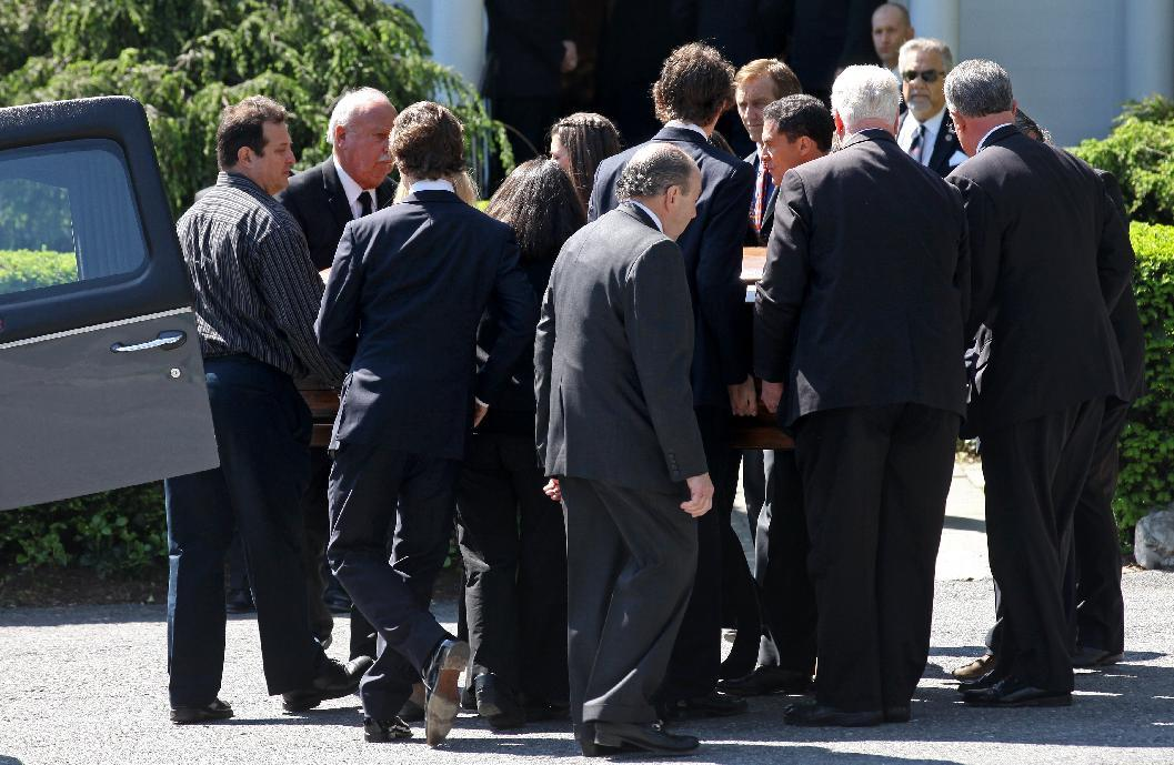 Members of Mary Richardson Kennedy's family remove the casket holding Kennedy, the estranged wife of Robert F. Kennedy Jr., at St. Patrick's Church in Bedford, N.Y., Saturday, May 19, 2012. Kennedy was found dead of an apparent suicide this week at her home in Bedford. Robert F. Kennedy Jr., is background center, facing camera. (AP Photo/Craig Ruttle)