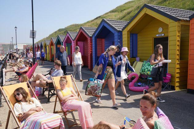 People by the beach at Saltburn-by-the-Sea in North Yorkshire on July 22. (Photo: Owen Humphreys - PA Images via Getty Images)