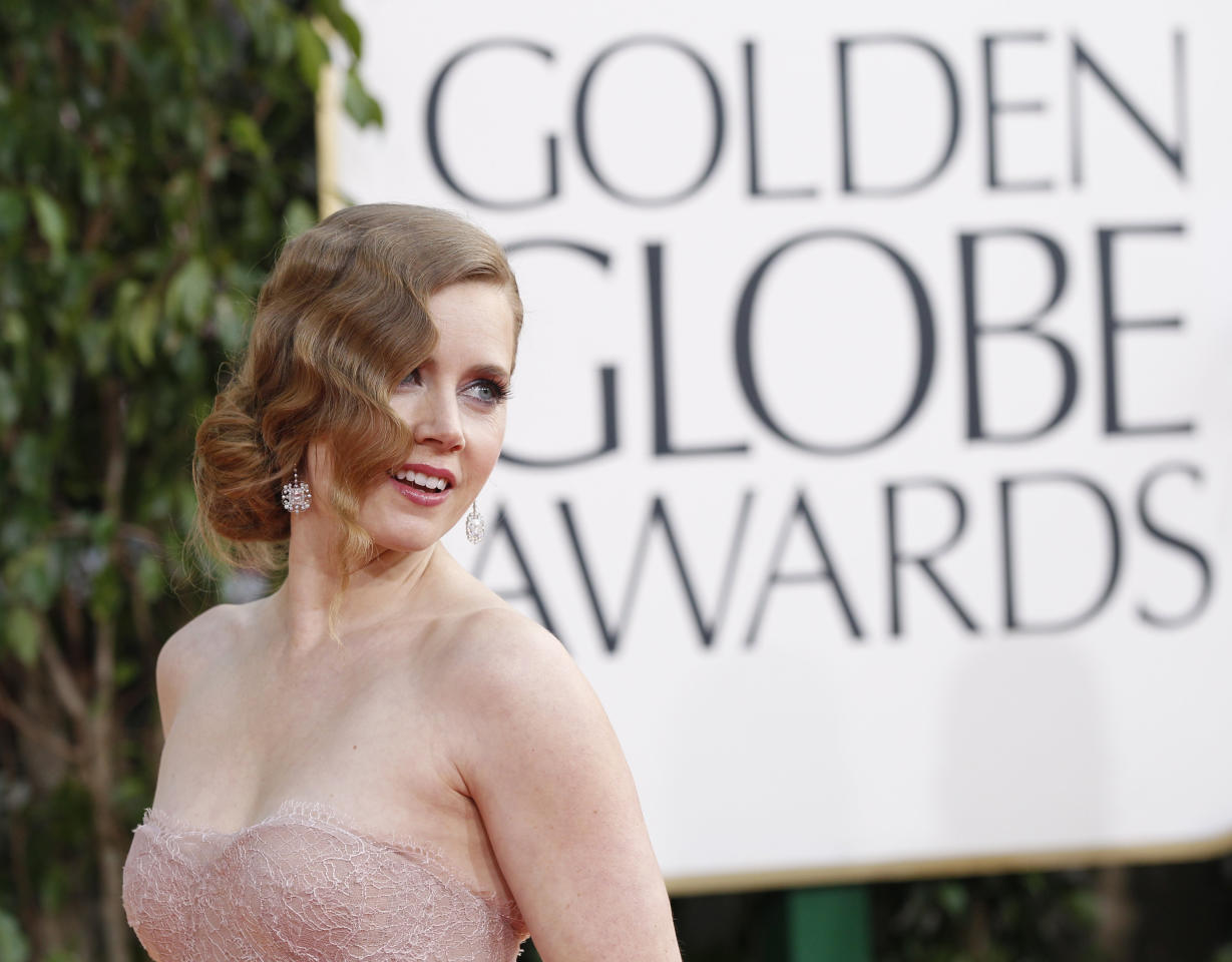 "Actress Amy Adams, from the film ""The Master,"" arrives at the 70th annual Golden Globe Awards in Beverly Hills, California, January 13, 2013.   REUTERS/Mario Anzuoni (UNITED STATES  - Tags: ENTERTAINMENT)  (GOLDENGLOBES-ARRIVALS)"