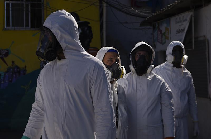 RIO DE JANEIRO, BRAZIL - JULY 25: Sanitary staff prepare to disinfect around against the novel coronavirus (COVID-19) pandemic in the Santa Marta Favela, south of the city, Rio de Janeiro, Brazil on July 25, 2020. Brazil has 85,562 thousand confirmed deaths from coronavirus until 1 pm on Saturday. (Photo by Fabio Teixeira/Anadolu Agency via Getty Images)