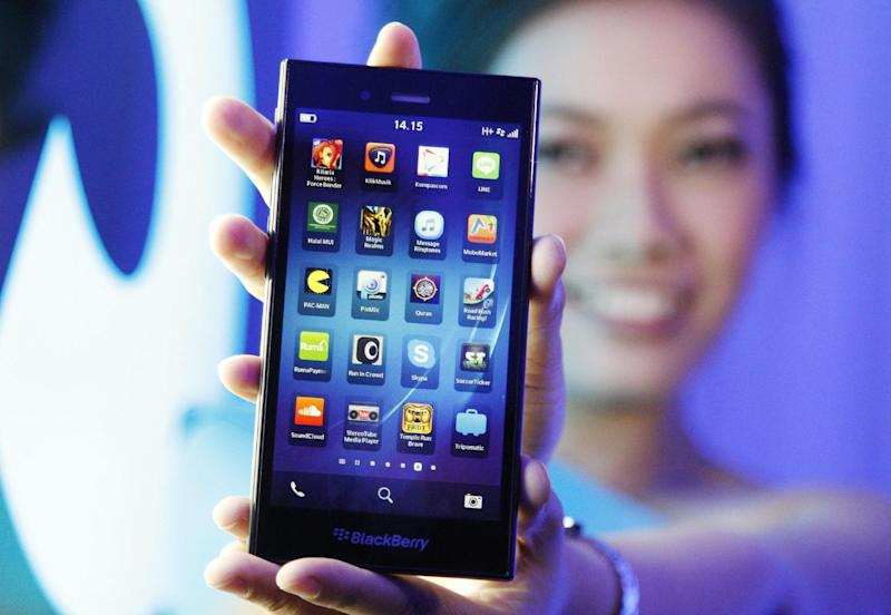 A Blackberry Z3 smartphone is shown by a model during its launch in Jakarta, Indonesia, Tuesday, May 13, 2014. The Z3 is priced at (US$200) in the country. (AP Photo/Achmad Ibrahim)