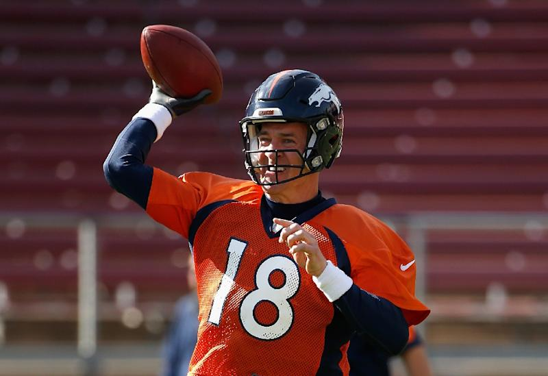 Peyton Manning of the Denver Broncos throws the ball during practice at Stanford Stadium in Stanford, California on February 4, 2016
