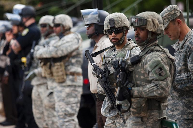 National Guard members and police hold their position at City Hall during a protest in downtown Baltimore, Maryland on April 29, 2015
