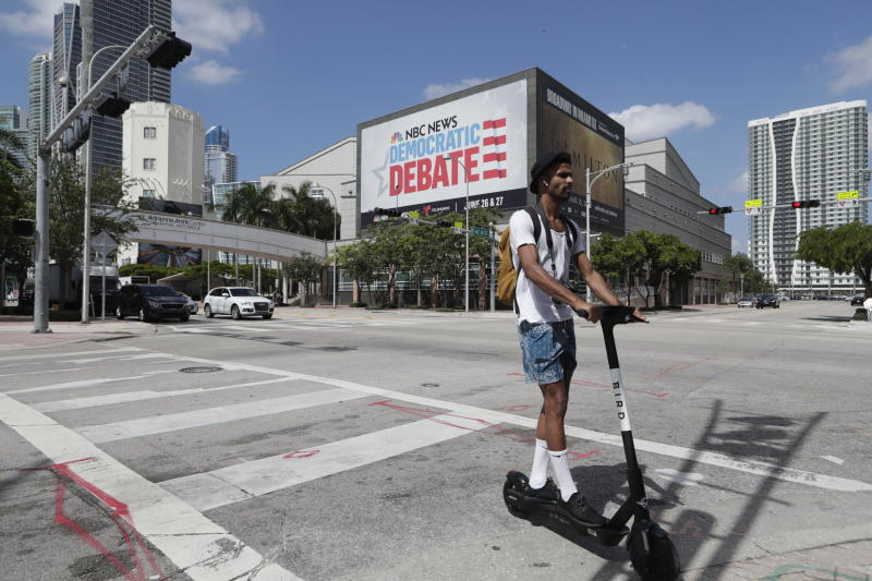 A billboard advertises the Democratic presidential debates across from the Knight Concert Hall at the Adrienne Arsht Center for the Performing Arts Monday, June 24, 2019, in Miami. (AP Photo/Lynne Sladky)