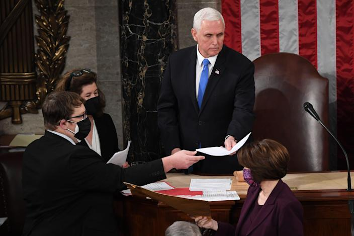 Vice President Mike Pence presides over a joint session of Congress on Jan. 6 to certify electoral votes in the 2020 election, a day when the proceedings were disrupted when rioting supporters of President Trump broke into the Capitol.