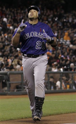 Colorado Rockies' Wilin Rosario (20) celebrates after hitting a solo home run off of San Francisco Giants pitcher Ryan Vogelsong during the fourth inning of a baseball game in San Francisco, Monday, May 14, 2012. (AP Photo/Jeff Chiu)