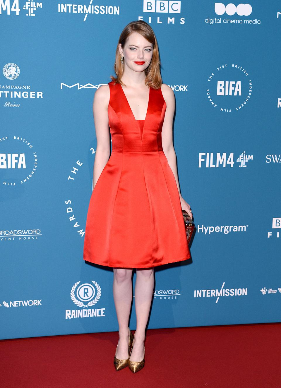 <p>The American actress looked festive in a satin Louis Vuitton dress. <em>[Photo: Getty]</em> </p>