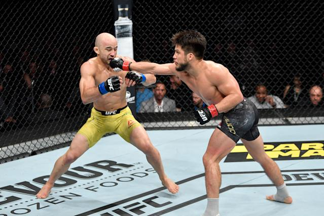 Henry Cejudo punches Marlon Moraes during UFC 238 at the United Center on June 8, 2019 in Chicago. (Getty Images)
