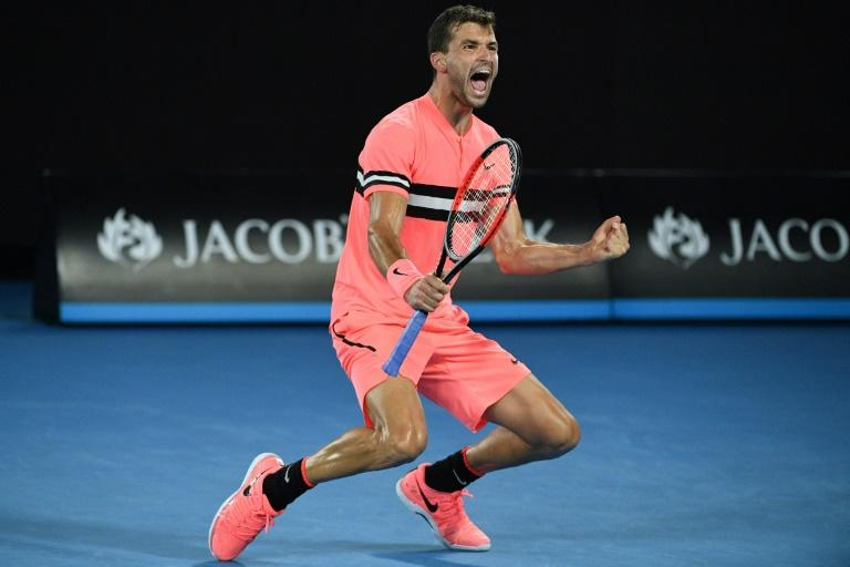 Bulgaria's Grigor Dimitrov celebrates beating Australia's Nick Kyrgios in their men's singles match at the Australian Open in Melbourne on January 21, 2018