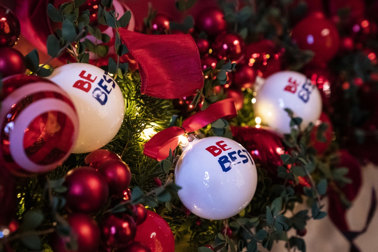 Ornaments with the First Lady's Be Best initiative logo hang over a mantle during the White House Christmas preview in the Red Room of the White House on Monday, Nov. 26, 2018 in Washington, D.C. (Photo: Jabin Botsford/The Washington Post via Getty Images)