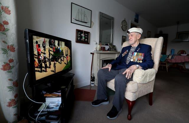 Malcolm Clerc, 94, watching the funeral on tv