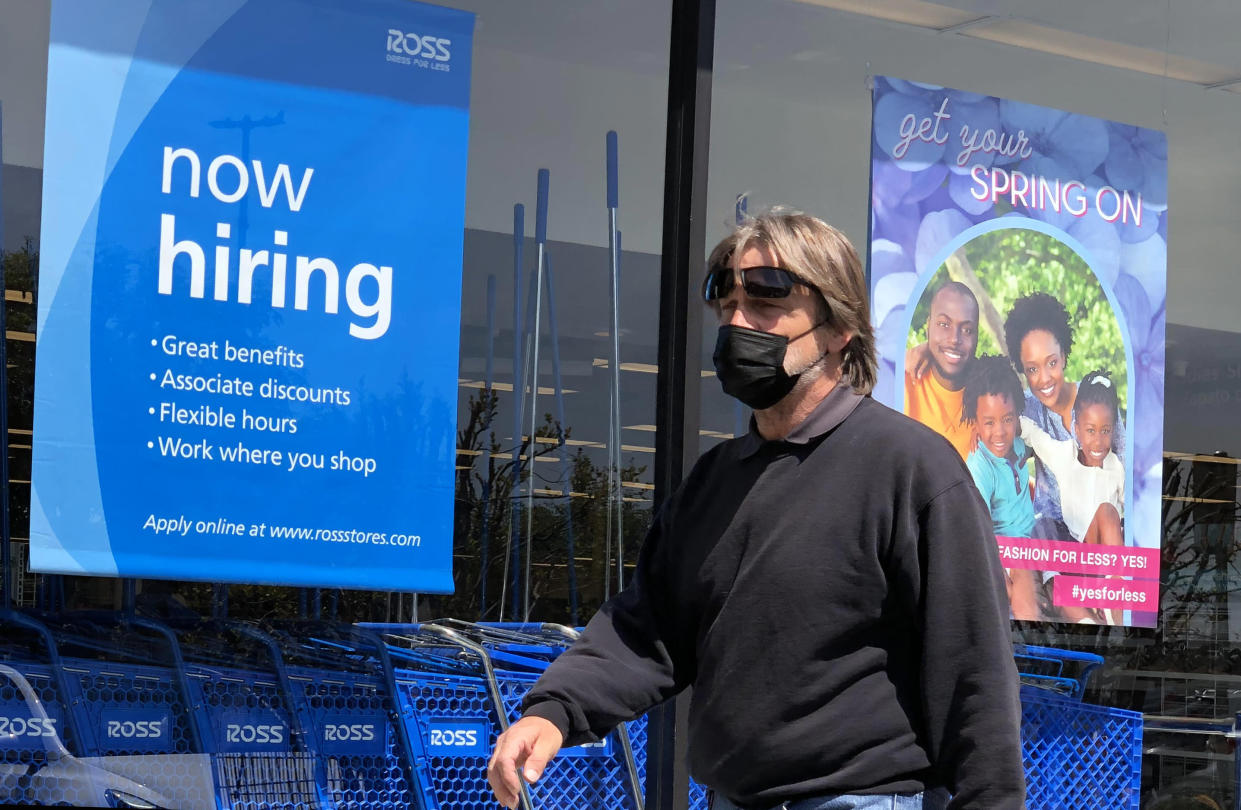 A pedestrian walks by a now hiring sign at Ross Dress For Less store on April 02, 2021 in San Rafael, California. According to a report by the Bureau of Labor Statistics, the U.S. economy added 916,000 jobs in March and the unemployment rate dropped to 6 percent. (Justin Sullivan/Getty Images)