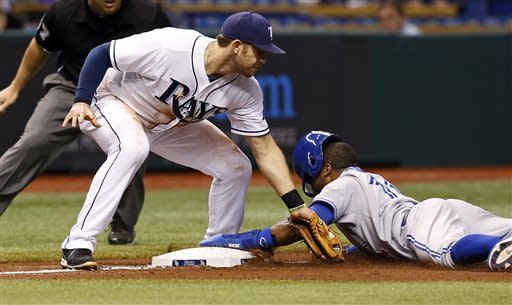 Scott draws bases-loaded walk, Rays win in 10