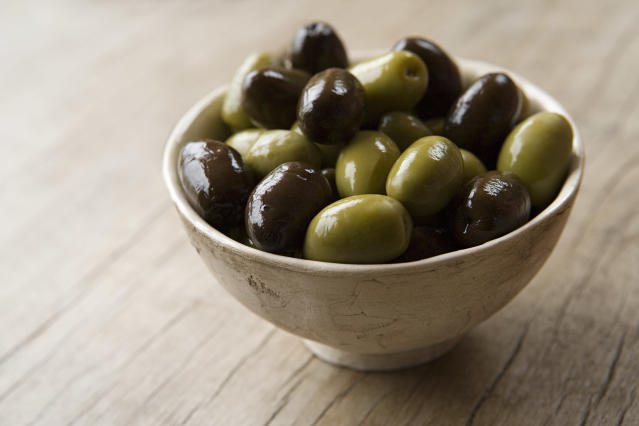 Olives are technically a fruit, but tend to be cured in salt. (Getty Images)