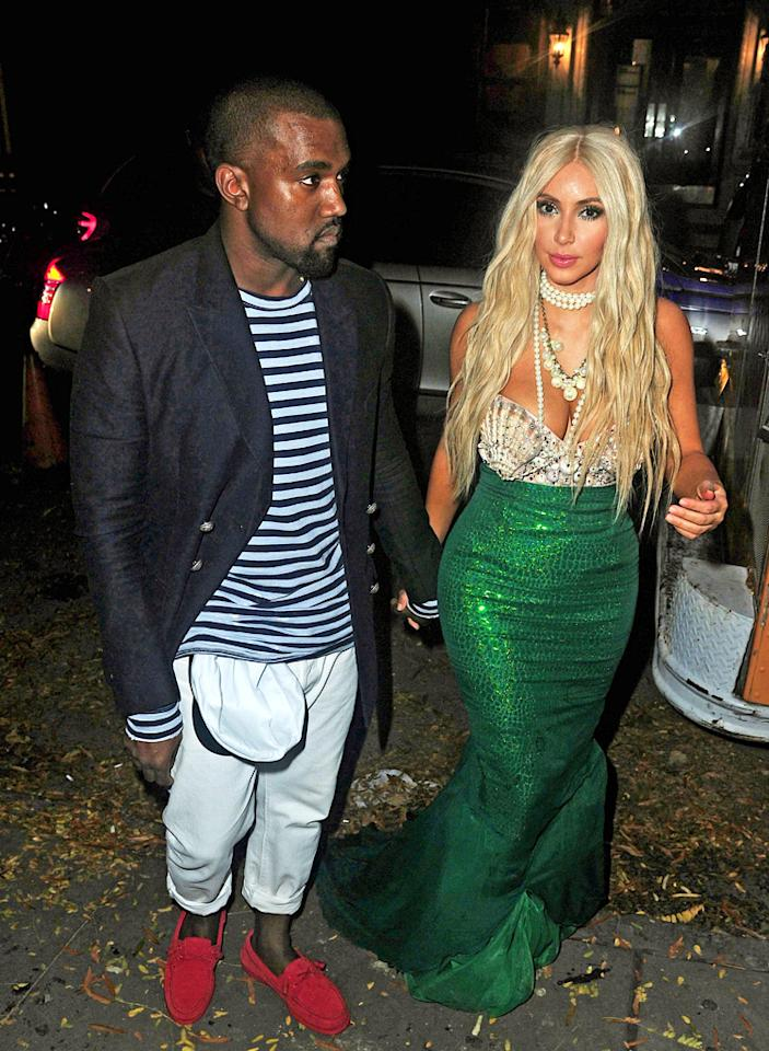 "Kim Kardashian donned a glittering tail, seashell bodice, and a blond wig as she dressed up as a mermaid — more like the ""Splash"" mermaid Madison, not ""The Little Mermaid's"" Ariel, as she specified on her blog — when she hosted the 2nd Annual Midori Green Halloween at NYC club Avenue on Saturday. Kardashian's date, beau Kanye West, who often coordinates his look with his lady's, sported a nautical-themed ensemble. Anything Kardashian does to celebrate Halloween this year will be better than last, since October 31, 2011, was the date she filed for divorce from Kris Humphries! (10/27/2012)"
