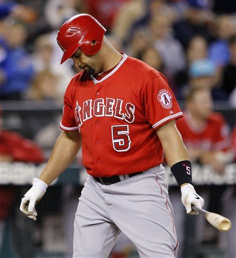 Los Angeles Angels' Albert Pujols turns away from the plate after striking out swinging against the Seattle Mariners during the third inning of a baseball game, Tuesday, Oct. 2, 2012, in Seattle. (AP Photo/Elaine Thompson)