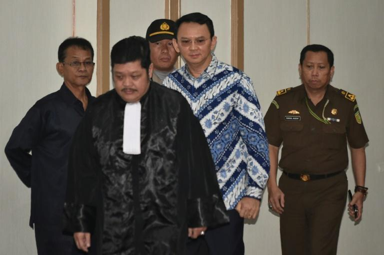 Jakarta's Christian governor Basuki Tjahaja Purnama (2nd R), popularly known as Ahok, arrives at a courtroom for a verdict and sentence in his blasphemy trial