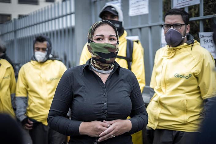 """Yuly Ramírez, a mother and former lawyer from Venezuela, speaks during a global drivers protest last April in Quito, Ecuador. Ramírez has become an organizer and spokesperson demanding drivers' rights.<span class=""""copyright"""">Isadora Romero</span>"""
