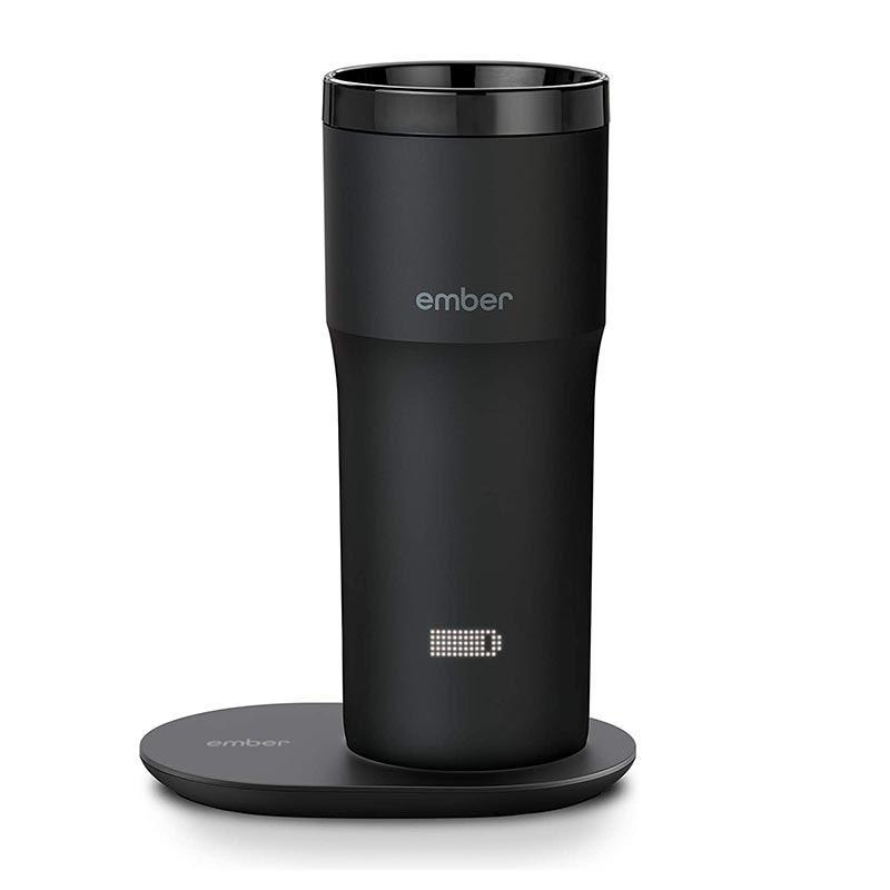 "Meet the high-tech upgrade for the busy bee on your list. This app-controlled smart travel mug will keep his Joe nice and hot so it's all set when he's ready to fly out the door. $180, Amazon. <a href=""https://www.amazon.com/Ember-Travel-Mug-Black-Gen/dp/B07NQSJRBZ"" rel=""nofollow noopener"" target=""_blank"" data-ylk=""slk:Get it now!"" class=""link rapid-noclick-resp"">Get it now!</a>"